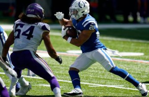 Colts enter win column with defense, running game