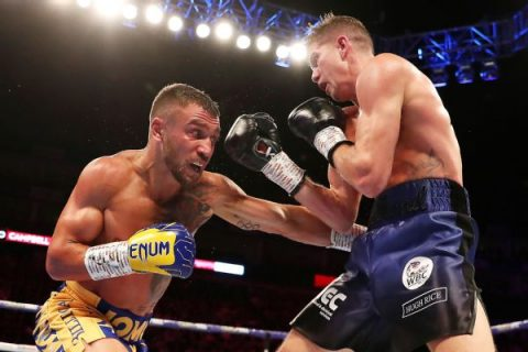 Loma tops Campbell, adds WBC to title collection